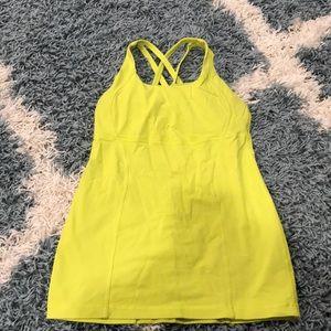 Neon yellow cross back lululemon tank, size 6.
